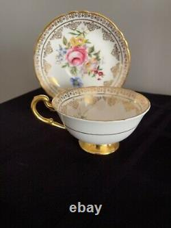 Paragon Tea Cup Saucer Large Cabbage Rose Floral Footed Heavy Gold